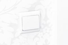 Interruptor branco da parede - contato e luz Fotos de Stock