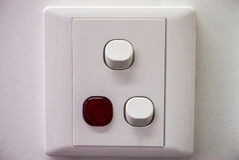 Interruptor da alimentação CA em uma parede Foto de Stock