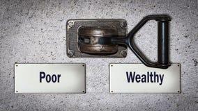 Interruptor da parede rico contra pobres imagem de stock royalty free