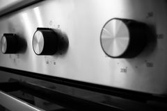 Interruptor de control eléctrico de la estufa de cocina Imágenes de archivo libres de regalías