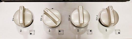 Interruptor de control eléctrico de la estufa de cocina, blanco y negro Imágenes de archivo libres de regalías