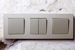 Interruptor de la luz en la pared Imagenes de archivo