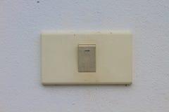 Interruptor de la luz en la pared vieja Imágenes de archivo libres de regalías