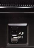 Interruptor de modo do foco na lente foto de stock royalty free