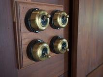 Interruptor del latón de cuatro obras clásicas imágenes de archivo libres de regalías