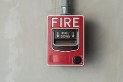 Interruptor do fogo na parede fotografia de stock