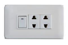 Interruptor eléctrico y zócalos aislados en el fondo blanco Fotos de archivo libres de regalías