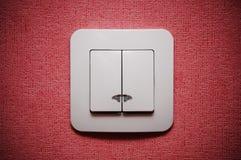 Interruptor ligero doble contra la pared roja Fotografía de archivo libre de regalías