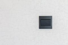 Interruptor negro, en blanco para el espacio de la copia imagen de archivo