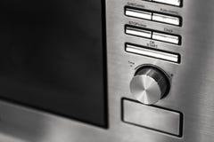 Interruptor novo limpo do volume do calor do botão do fogão da micro-ondas da cozinha do close up fotografia de stock royalty free
