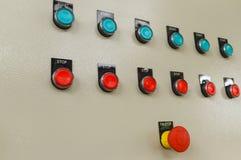 Interruptor vermelho da emergência e da parada com teclas 'Iniciar Cópias' verdes Fotos de Stock