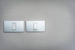 Interruptores de la luz grises en fondo de la textura Copie el espacio Imagenes de archivo