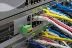Interruptores de las telecomunicaciones con los cordones de remiendo coloreados Fotografía de archivo libre de regalías
