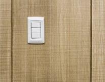 Interruptores eléctricos en la pared de la madera contrachapada Imágenes de archivo libres de regalías