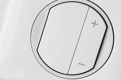 Interruttore della luce bianco di plastica del regolatore della luminosità fotografia stock