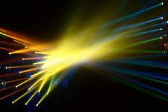 Intersecting multi-colored rays of spotlights royalty free stock photography