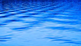 Intersecting waves on blue lake ripple in abstract royalty free stock photos