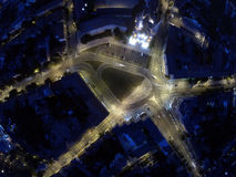 Intersection from above at night. Intersection photographed from above at night by a drone, aerial view by a drone Royalty Free Stock Photo