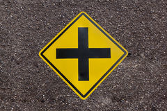 Intersection ahead sign on asphalt road texture background Stock Images