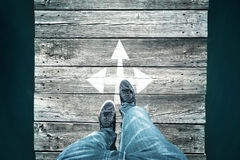 Intersection arrow with man legs Stock Images