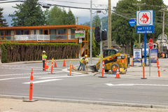 An intersection being widened at harrison hot springs, canada. Workers at a road construction site in a popular tourist destination in british columbia Royalty Free Stock Image