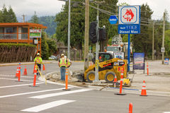 An intersection being widened at harrison hot springs, canada. Workers at a road construction site in a popular tourist destination in british columbia Stock Photos