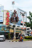 Intersection in central Krabi Town, with giant caveman statues, Royalty Free Stock Photography