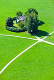 Intersection of five walking paths in green field Royalty Free Stock Photo
