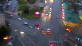 The intersection with the machines through a wet window in the rain stock footage