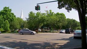 Intersection near Center Green (1 of 2). A traffic intersection in a small town stock footage