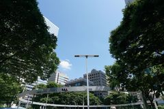 Intersection near Shinjuku police station. Tokyo, Japan-June 17, 2017: The intersection is known by the big circle beam holding traffic lights Royalty Free Stock Images