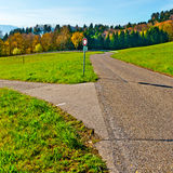 Intersection. Of Rural Roads Leading to the Farmhouses in the Swiss Alps Royalty Free Stock Photos