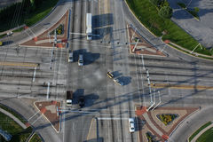 Intersection seen from above with cars and truck in their lanes. Traffic seen from above at intersection various cars and truck obeying the signs royalty free stock photo