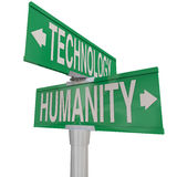 Intersection of Technology and Humanity Modern Digital Age Vs Na. Intersection of Technology and Humanity illustrated on two green street or road signs pointing Stock Photos