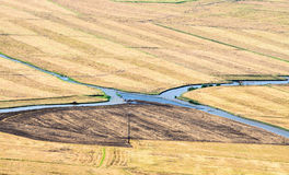 Intersection  of two canals  on farmland Royalty Free Stock Photo