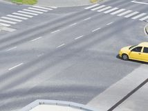 Intersection with Yellow Car Stock Photos