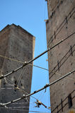 Intersections in Bologna. Tram lines intersects the towers of bologna Royalty Free Stock Images