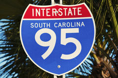 Interstate 95 in South Carolina. Sign seen against palm tree Royalty Free Stock Photos