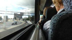 Interstate Bus. Passengers aboard a bus traveling between Newark, New Jersey, and Manhattan, New York stock video footage