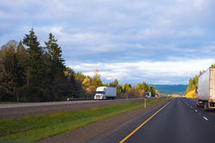 Interstate highway with divided traffic lines and semi trucks dr Royalty Free Stock Image