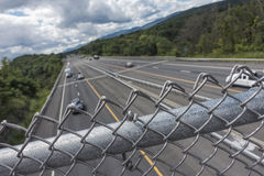 Interstate highway with fence Royalty Free Stock Images