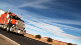 Interstate Highway Semi Truck. Low dutch angle on a semi truck passing camera along U.S. Interstate 40 (I-40) about 30 miles West of Albuquerque, New Mexico stock footage