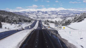 Interstate Highway in Snowy Mountains stock video footage