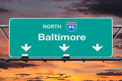Interstate 95 to Baltimore Highway Sign with Sunrise Sky Stock Images