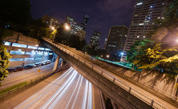 Interstate 5 Travels Underneath Roads Parks Buildings Seattle WA. A long exposure at night over the expressway in Seattle Washington stock image