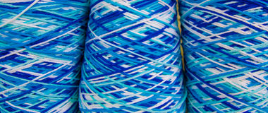 Intertwined colored yarn Stock Photography