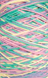 Intertwined colored yarn skeins Royalty Free Stock Photo