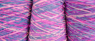 Intertwined colored yarn skeins Royalty Free Stock Images