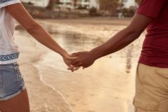 Intertwined fingers with reflections in water Stock Photo