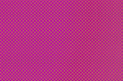 Intertwined grid - red-violet and sandy brown squares pattern. Stock Photo
